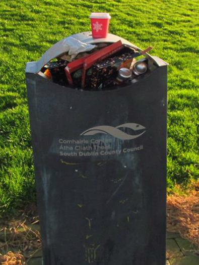 Full rubbish bins in Sean Walsh Memorial Park